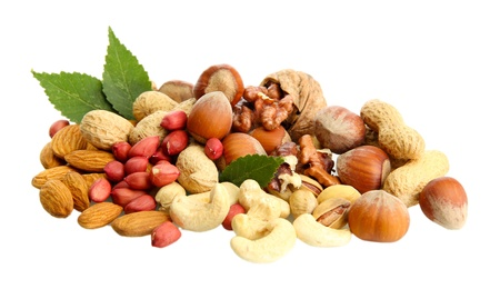 assortment of tasty nuts with leaves, isolated on white Stock Photo