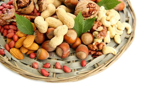 assortment of tasty nuts, isolated on white Stock Photo - 15938236
