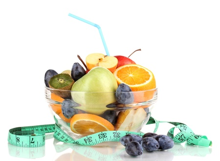 Glass bowl with fruit for diet and measuring tape isolated on white Stock Photo - 15920967