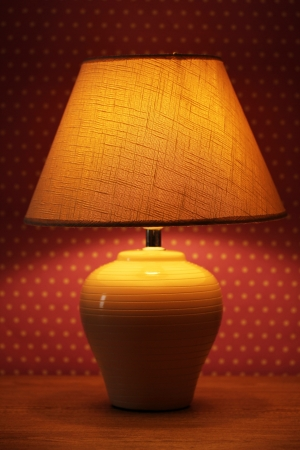 table lamp on wallpaper background  Stock Photo - 15938326