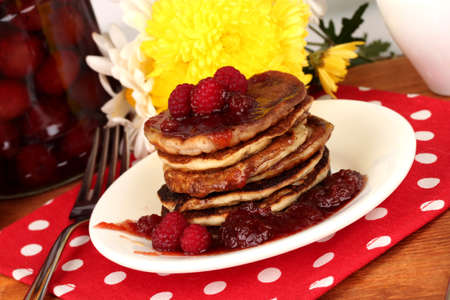 delicious sweet pancakes on wooden background photo