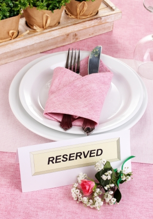 Table setting with reserved card in restaurant Stock Photo - 15924019