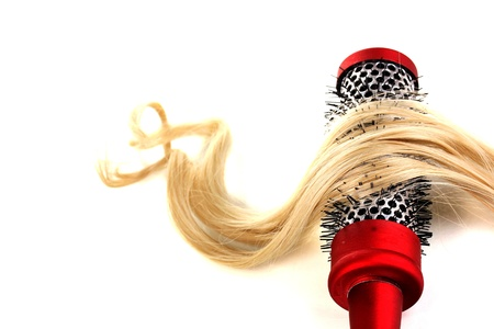 Blond curls brushing comb isolated on white Stock Photo - 15922962