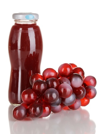 Delicious grapes juice in glass bottle and pink grapes next to it isolated on white Stock Photo - 15922524