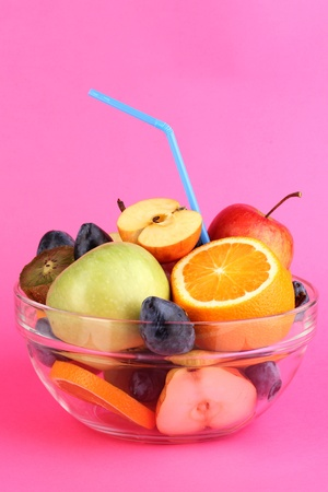 Glass bowl with fruit for diet on pink background Stock Photo - 15923796