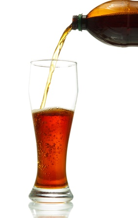 kvass poured into a glass, isolated on white photo