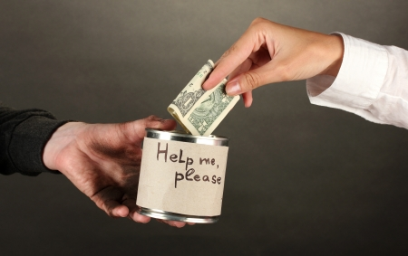 helping the homeless, on black background close-up Stock Photo - 15943279