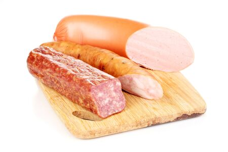Tasty sausage on chopping board isolated on white photo