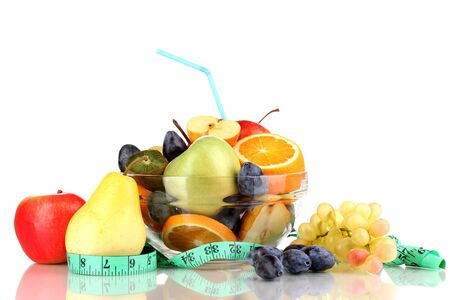 Glass bowl with fruit for diet and measuring tape isolated on white Stock Photo - 15943215