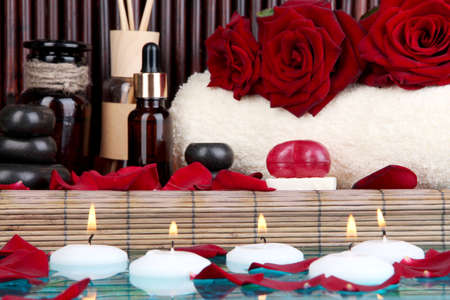 Beautiful spa setting near pool on bamboo background photo