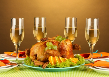 thanksgiving dinner: banquet table with roast chicken on brown background close-up. Thanksgiving Day