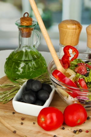 Fresh greek salad in glass bowl surrounded by ingredients for cooking on wooden table on window background Stock Photo - 15959949