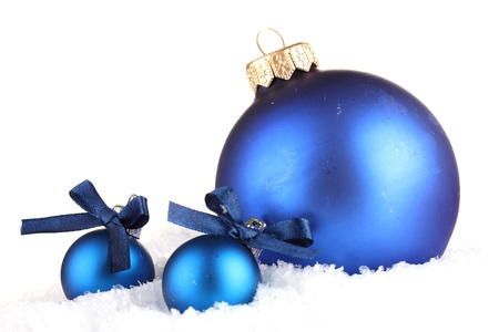 group of christmas baubles: beautiful blue Christmas balls on snow, isolated on white