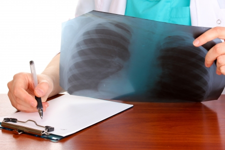 Doctor describes radiograph patient isolated on white Stock Photo - 15958861