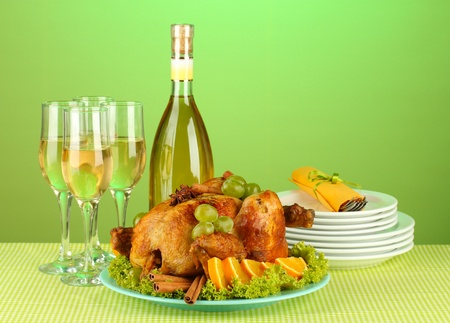 table setting for Thanksgiving day on green background close-up photo
