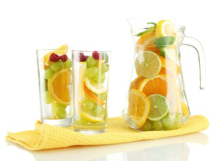 transparent jar and glasses with citrus fruits and raspberries, isolated on white Stock Photo - 15961943