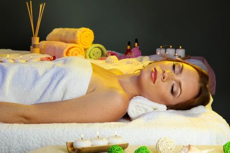 beautiful young woman in spa salon photo