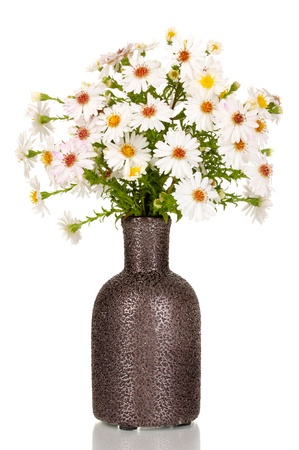 beautiful bouquet of white flowers in vase isolated on white photo