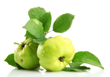 quinces: sweet quinces with leaves, isolated on white Stock Photo