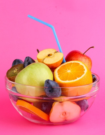 Glass bowl with fruit for diet on pink background Stock Photo - 15994697