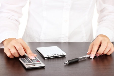 Woman's hands counts on the calculator, close-up Stock Photo - 16078816