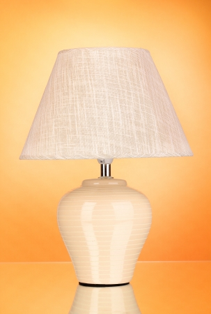 table lamp on orange background photo