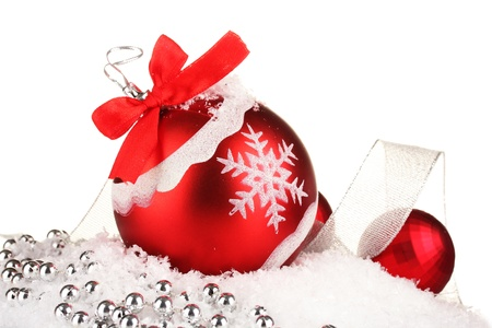 beautiful bright Christmas balls on snow, isolated on white Stock Photo - 16078209