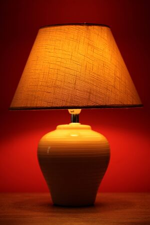 table lamp on wallpaper background  photo
