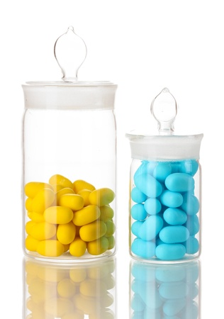linctus: Transparent bottles with pills isolated on white