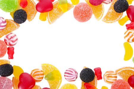 frame of colorful jelly candies isolated on white photo