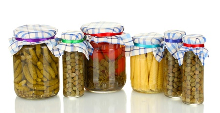 Jars canned vegetables isolated on white photo