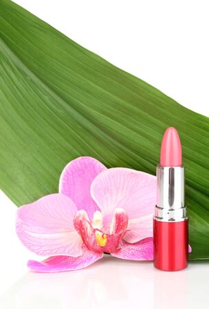 lipstick on green leaf isolated on white photo