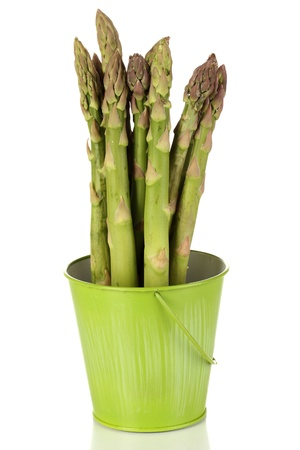 nutritiously: Fresh asparagus in green pail isolated on white