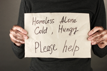 homeless man: homeless man asks for help, on black background close-up Stock Photo