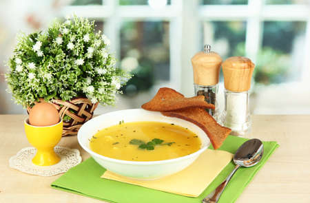 Fragrant soup in white plate on table on window background close-up Stock Photo - 16106435