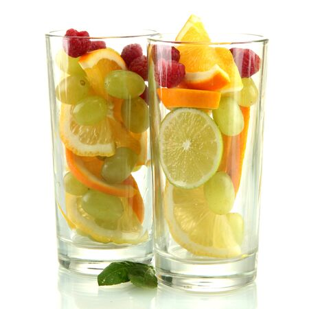 transparent glasses with citrus fruits, isolated on white Stock Photo - 16106288