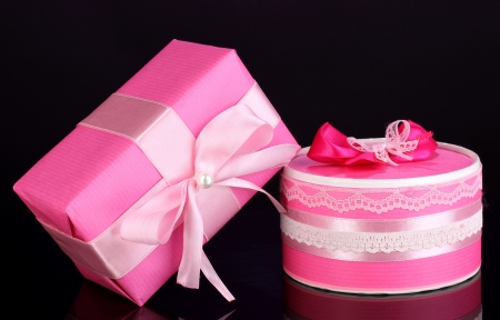 Colorful pink gifts on purple background photo
