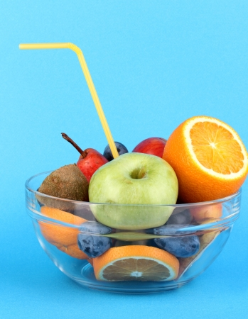 Glass bowl with fruit for diet on blue background Stock Photo - 16106246