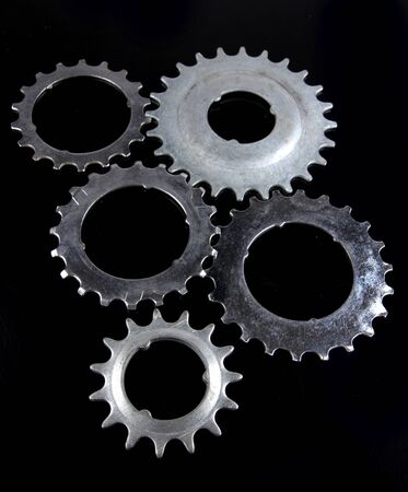 Metal cogwheels on black background photo