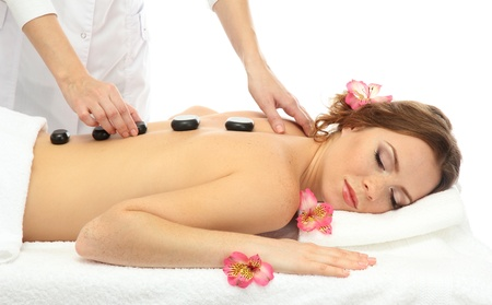 getting: beautiful young woman in spa salon getting massage with spa stones Stock Photo