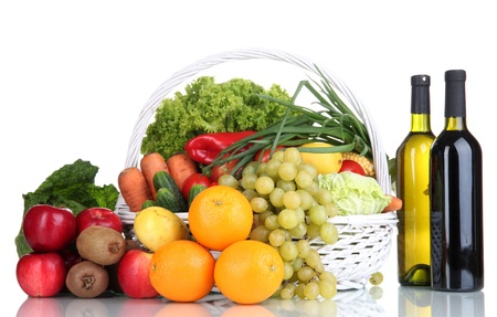 Composition with vegetables and fruits in wicker basket isolated on white Stock Photo - 16106146