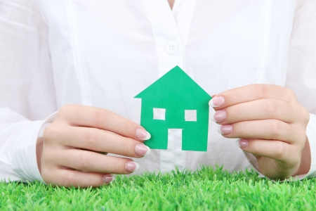 concept: woman hands with paper house, close up Stock Photo - 16106216