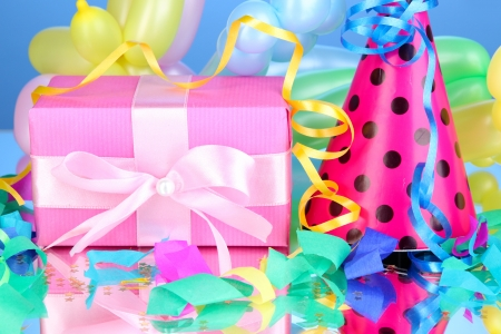 Colorful gift boxes on blue background photo