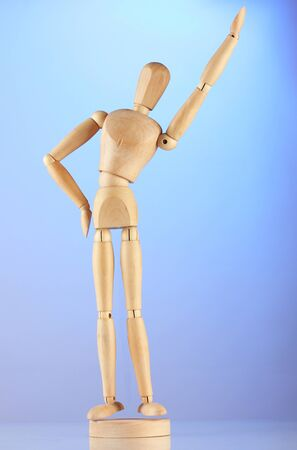 wooden mannequin, on blue background Stock Photo - 16106890