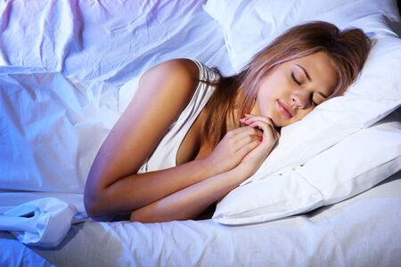 young beautiful woman sleeping on bed in bedroom Stock Photo - 17129733