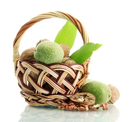 walnuts with green leaves in basket, isolated on white Stock Photo - 16106752