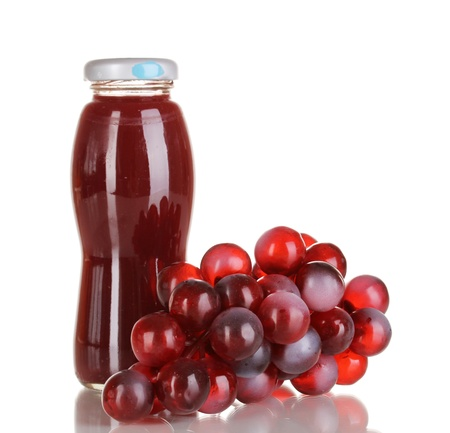 Delicious grapes juice in glass bottle and pink grapes next to it isolated on white Stock Photo - 16106636