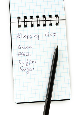 shopping list in a notebook on white background close-up Stock Photo - 16106833