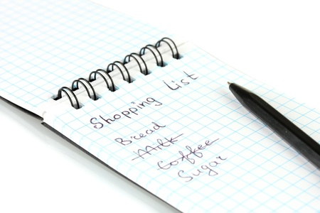 shopping list in a notebook on white background close-up Stock Photo - 16106781