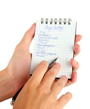 woman's hand holding a notebook with a shopping list close-up Stock Photo - 16106737